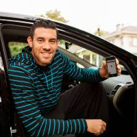 Photo - Nick Collison with the Oklahoma City Thunder used the Uber application on his smart phone to call for a ride through the new transportation service that just arrived here last week. PHOTO PROVIDED.