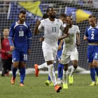 Photo - Ivory Coast's Didier Drogba (11) celebrates after scoring on a penalty kick during the second half in an international friendly soccer match against Bosnia-Herzegovina on Friday, May 30, 2014, in St. Louis. Bosnia-Herzegovina won 2-1. (AP Photo/Jeff Roberson)