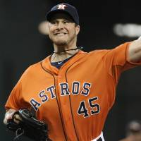 Photo - Houston Astros' Erik Bedard delivers a pitch against the Chicago White Sox in the first inning of a baseball game, Friday, June 14, 2013, in Houston. (AP Photo/Pat Sullivan)