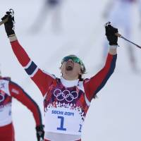 Photo - Norway's Maiken Caspersen Falla crosses the finish line to win gold in the final of the women's cross-country sprint at the 2014 Winter Olympics, Tuesday, Feb. 11, 2014, in Krasnaya Polyana, Russia. (AP Photo/Matthias Schrader)