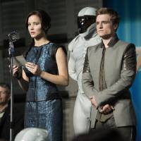 Photo - Jennifer Lawrence plays Katniss Everdeen and Josh Hutcherson plays Peeta Mellark in the sequel