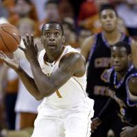 Photo -   Texas' Sheldon McClellan, left, looks to shoot as he grabs the loose ball with Coppin State's Andre Armstrong, right, and Brandon St. Louis, center, following, during the first half of an NCAA college basketball game, Monday, Nov. 12, 2012, in Austin, Texas. (AP Photo/Eric Gay)