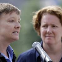 Photo - Plaintiffs Isabelle Barker, left, and her spouse Cara Palladino speak during a news conference, Thursday, Sept. 26, 2013, near Independence Hall in Philadelphia. Cara Palladino and Isabelle Barker, who were legally married in Massachusetts and moved to Pennsylvania, filed a federal lawsuit Thursday aiming to overturn the 1996 amendment to a state law stating same-sex marriages, including those recorded elsewhere, are not legal within the state.(AP Photo/Matt Rourke)