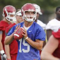 Photo - COLLEGE FOOTBALL: Quarterback Drew Allen (15) throws during the University of Oklahoma (OU) Sooners first day of practice on Thursday, August 4, 2011, in Norman, Okla.   Photo by Steve Sisney, The Oklahoman ORG XMIT: KOD
