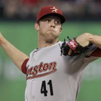 Photo - Houston Astros starting pitcher Jordan Lyles (41) delivers to the Texas Rangers in the first fourth inning of an interleague baseball, Tuesday, June 21, 2011, in Arlington, Texas. (AP Photo/Tony Gutierrez)