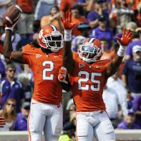 Photo -   Clemson's Sammy Watkins (2) celebrates with Roderick McDowell (25) after scoring a touchdown in the second quarter of an NCAA college football game against Furman, Saturday, Sept. 15, 2012, in Clemson, S.C. (AP Photo/Rainier Ehrhardt)