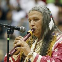 Photo - Native American musician Albert Gray Eagle performs on an Indian flute during a multicultural performance day at Edmond Santa Fe High School in Edmond, OK, Friday, March 14, 2008. BY PAUL HELLSTERN, THE OKLAHOMAN ORG XMIT: KOD
