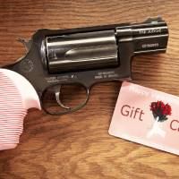 Photo - Far Left: A pink handgun and Valentine's Day gift card from H&H Shooting Sports Complex in Oklahoma City. PHOTO PROVIDED