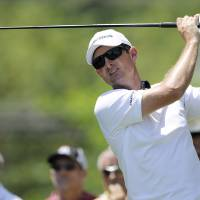 Photo - Justin Rose, of England, watches his tee shot on the third tee during the final round of the Quicken Loans National golf tournament, Sunday, June 29, 2014, in Bethesda, Md. (AP Photo/Nick Wass)
