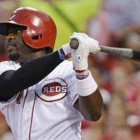 Photo - Cincinnati Reds' Brandon Phillips watches his three-run double off Pittsburgh Pirates relief pitcher Justin Wilson in the fifth inning of a baseball game, Friday, July 19, 2013, in Cincinnati. (AP Photo/Al Behrman)