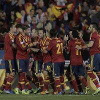 Photo - Spain's players celebrate Xavi Hernandez's goal during a 2014 World Cup Group I qualifying soccer match between Spain and Belarus at the  Iberostar Estadi in Palma de Mallorca, Spain, Friday Oct. 11, 2013. (AP Photo/Manu Mielniezuk)