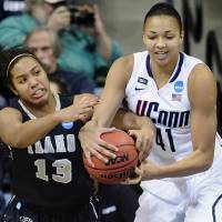 Photo - Idaho's Ali Forde, left, and Connecticut's Kiah Stokes fight for a rebound in the first half of a first-round game in the women's NCAA college basketball tournament in Storrs, Conn., Saturday, March 23, 2013. (AP Photo/Jessica Hill)