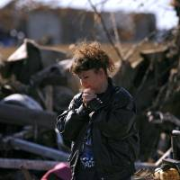 Photo - TORNADO / STORM / DAMAGE: Neda Wilson reacts as she looks at her sister's destroyed home following deadly storms around Lone Grove, Okla., Feb. 11, 2009. By John Clanton, The Oklahoman ORG XMIT: KOD