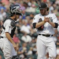 Photo - Chicago White Sox catcher Adrian Nieto, left, talks to relief pitcher Daniel Webb during the seventh inning of a baseball game against the Houston Astros in Chicago on Sunday, July 20, 2014. (AP Photo/Nam Y. Huh)