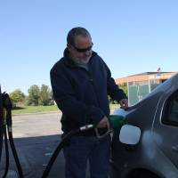 Photo - Jesse Staley of Moore on Friday filled up his 2002 diesel-powered Volkswagen Jetta at the Murphy USA station at 104th and South Western for $3.85 a gallon even as regular unleaded gasoline was selling for $2.95.  The average price of gasoline in Oklahoma City has dropped 50 cents over the past month.  Adam Wilmoth - photo by