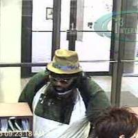 Photo - Surveillance photos of a robbery at Bank of Oklahoma, 11300 N May Avenue, on Monday morning.
