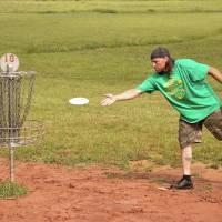 Photo - Kevin Custard plays disc golf during an April tournament at the Tye F. Cunningham Memorial Disc Golf Course at J.L. Mitch Park in Edmond. OKLAHOMAN ARCHIVE PHOTO