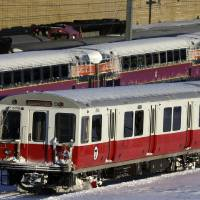 Photo - Massachusetts Bay Transportation Authority commuter trains wait to  start running again early Sunday, Feb. 10, 2013 in Boston. The MBTA hopes to have commuter train service fully restored for the Monday morning rush hour. (AP Photo/Gene J. Puskar)