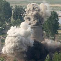 Photo - FILE -  In this June 27, 2008 file photo released by China's Xinhua News Agency, the cooling tower of the Nyongbyon nuclear complex is demolished in Nyongbyon, also known as Yongbyon, North Korea.   North Korea vowed Tuesday, April 2, 2013,  to restart a nuclear reactor that can make one bomb's worth of plutonium a year, escalating tensions already raised by near daily warlike threats against the United States and South Korea. The North's plutonium reactor was shut down in 2007 as part of international nuclear disarmament talks that have since stalled. The declaration of a resumption of plutonium production — the most common fuel in nuclear weapons — and other facilities at the main Nyongbyon nuclear complex will boost fears in Washington and among its allies about North Korea's timetable for building a nuclear-tipped missile that can reach the United States, technology it is not currently believed to have.   (AP Photo/Xinhua, Gao Haorong, File) NO SALES