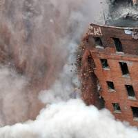 Photo - The 11-story Wellington Annex on Howard St. is imploded Saturday morning, Aug. 23, 2014, to make way for Albany's new convention center in Albany, N.Y. (AP Photo/Times Union, Will Waldron)