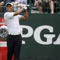 Photo - Tiger Woods watches his tee shot  on the first hole during the second round of the PGA Championship golf tournament at Valhalla Golf Club on Friday, Aug. 8, 2014, in Louisville, Ky. (AP Photo/Jeff Roberson)