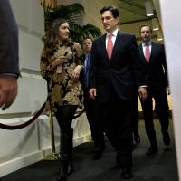 Photo - House Majority Leader Eric Cantor, R-Va., center, leaves a second Republican caucus meeting to discuss the