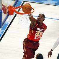 Photo -   Western Conference's Kevin Durant (35), of the Oklahoma City Thunder, dunks over Eastern Conference's Dwight Howard (12), of the Orlando Magic, during the first half of the NBA All-Star basketball game, Sunday, Feb. 26, 2012, in Orlando, Fla. (AP Photo/Lynne Sladky)