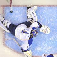 Photo -   St. Louis Blues goalie Brian Elliott is scored on by Los Angeles Kings right wing Justin Williams during the first period in Game 3 of an NHL hockey Stanley Cup second-round playoff series, Thursday, May 3, 2012, in Los Angeles. (AP Photo/Mark J. Terrill)