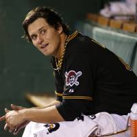 Photo - Pittsburgh Pirates starting pitcher Jeff Locke sits in the dugout during the fifth inning of a baseball game against the Miami Marlins in Pittsburgh on Wednesday, Aug. 6, 2014. The Pirates won 7-3, with Locke getting the win. (AP Photo/Gene J. Puskar)