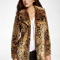 Photo - Vanessa Hudgens is taking more adult roles but keeping her youthful, slightly punk edge in her personal style. Get her look with this faux leopard fur coat ($138.60 from Express.com). (Express.com/Los Angeles Times/MCT)