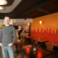 Photo - Chef Joseph Royer will soon open a third Saturn Grill location in Midtown.  Jaconna Aguirre - The Oklahoman