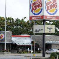 Photo - A Burger King restaurant is seen on W. 26th Street in Millcreek Township, Pa., Tuesday, Aug. 26, 2014. Burger King struck an $11 billion deal to buy Tim Hortons that would create the world's third largest fast-food company and could make the Canadian coffee-and-doughnut chain more of a household name around the world. (AP Photo/Erie Times-News, Christopher Millette)