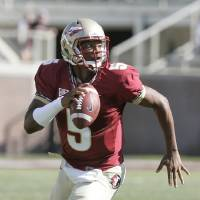 Photo - Florida State garnet quarterback Jameis Winston looks for a receiver as he scrambles in the second half of an NCAA college spring football game on Saturday, April 12, 2014, in Tallahassee, Fla. (AP Photo/Steve Cannon)