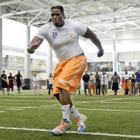 "Photo - In this photo provide by the University of Tennessee Athletics Department, Tennessee offensive tackle Antonio ""Tiny"" Richardson takes part in the school's NCAA college football pro day Wednesday, April 2, 2014, in Knoxville, Tenn. (AP Photo/Tennessee Athletics, Donald Page)"