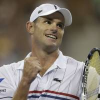 Photo -   Andy Roddick reacts after beating Australia's Bernard Tomic in the third round of play at the 2012 US Open tennis tournament, Friday, Aug. 31, 2012, in New York. (AP Photo/Charles Krupa)