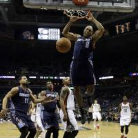 Photo - Charlotte Bobcats' Gerald Henderson dunks during the first half of an NBA basketball game against the Milwaukee Bucks, Saturday, Nov. 23, 2013, in Milwaukee. (AP Photo/Morry Gash)
