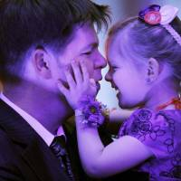 Photo - Jerimiah Russian and his daughter, Lizzie, 3, take a break from the dance floor during the Midwest City Parks and Recreation Department's annual Daddy-Daughter Dance. Photos by Jim Beckel, The Oklahoman