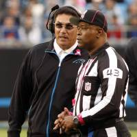 Photo -   Carolina Panthers head coach Ron Rivera, left, talks with field judge Terry Brown (43) during the second quarter of an NFL football game against the Seattle Seahawks in Charlotte, N.C., Sunday, Oct. 7, 2012. (AP Photo/Nell Redmond)
