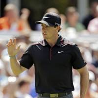 Photo - Rory McIlroy, from Northern Ireland, waves to the crowd after a birdie on the 13th hole during the first round of the Bridgestone Invitational golf tournament Thursday, July 31, 2014, at Firestone Country Club in Akron, Ohio. (AP Photo/Mark Duncan)