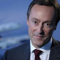 Photo - Fabrice Bregier, the CEO of Airbus, pauses during an interview with The Associated Press in Washington, Thursday, Oct. 24, 2013. (AP Photo/Susan Walsh)