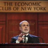 Photo -   Federal Reserve Chairman Ben Bernanke addresses a luncheon gathering of The Economic Club of New York, in New York, Tuesday, Nov. 20, 2012. Bernanke on Tuesday urged Congress and the Obama administration to strike a budget deal to avert tax increases and spending cuts that could trigger a recession next year. Without a deal, the measures known as the