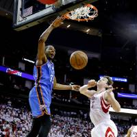 Photo - Oklahoma City's Kevin Durant dunks the ball beside Houston's Omer Asik during Game 3 in the first round of the NBA playoffs between the Oklahoma City Thunder and the Houston Rockets at the Toyota Center in Houston, Texas, Sat., April 27, 2013. Photo by Bryan Terry, The Oklahoman