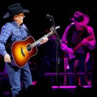 Photo -  George Strait performs during a concert at the Oklahoma City Arena on Saturday, Jan. 15, 2011. Photo by Bryan Terry, The Oklahoman Archives