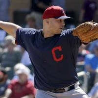Photo - Cleveland Indians starting pitcher Justin Masterson throws to an Arizona Diamondbacks batter during the first inning of an exhibition baseball game in Scottsdale, Ariz., Tuesday, March 11, 2014. (AP Photo/Chris Carlson)