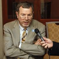 Photo - Head coach P.J. Carlesimo gives a radio interview during media day for the Oklahoma City Thunder NBA basketball team at the Skirvin Hilton hotel in Oklahoma City, Monday, September 29, 2008. BY NATE BILLINGS, THE OKLAHOMAN. ORG XMIT: KOD