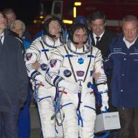 Photo - Russian Cosmonauts Alexander Misurkin, left, and Pavel Vinogradov, crew members of the mission to the International Space Station (ISS), walk to the rocket prior the launch of Soyuz-FG rocket at the Russian leased Baikonur Cosmodrome, Kazakhstan, Thursday, March 28, 2013. (AP Photo/ Shamil Zhumatov, Pool)