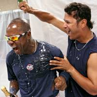 Photo - Oklahoma City's Esteban German (left) and Guillermo Moscoso celebrate their playoff berth with champagne after their game against the Omaha Royals at AT&T Bricktown Ballpark in Oklahoma City on Sunday, September 5, 2010.  Photo by John Clanton, The Oklahoman