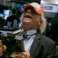 Photo - FILE - In this Tuesday, July 1, 2014, file photo, trader Peter Tuchman jokes with a handmade