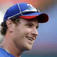 Photo - FILE - In this June 15, 2010 file photo, Texas Rangers' Josh Hamilton smiles smiles during batting practice before an interleague baseball game against the Florida Marlins in Miami. Rangers general manager Jon Daniels said Thursday, Dec. 13, 2012, that Hamilton has agreed to a contract with the Los Angeles Angels. (AP Photo/Lynne Sladky, File)