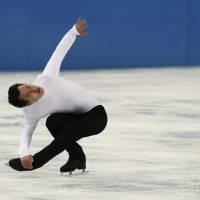 Photo - Patrick Chan of Canada practices during a figure skating practice session at the Iceberg Skating Palace ahead of the 2014 Winter Olympics, Monday, Feb. 3, 2014, in Sochi, Russia. (AP Photo/Mark Baker)